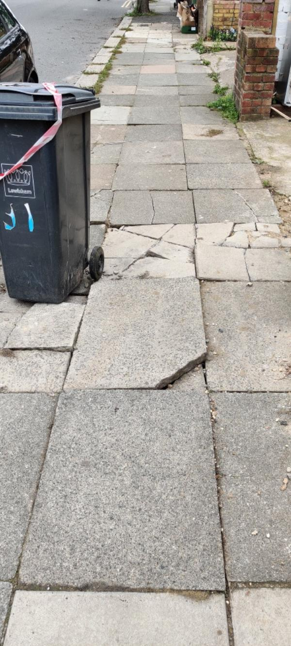 Damage to footpath from builders - loose, broken slabs and significant trip hazards-91 Dowanhill Road, London, SE6 1BX