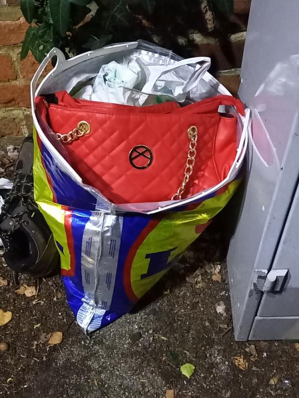 Bag of personal items and clothing/possessions fly tipped at the junction of Baker St and Prospect St.-3 Nicholas Court Prospect Street, Reading, RG1 7XR