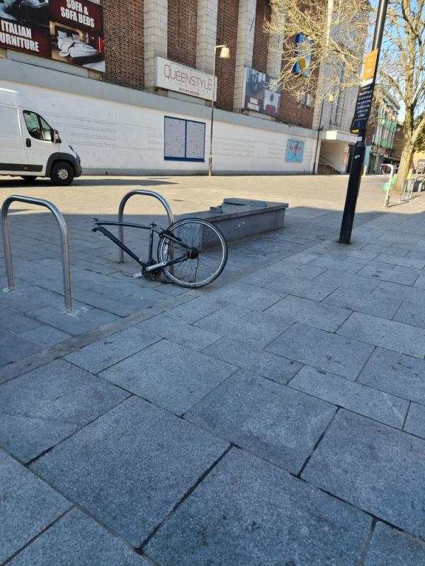Bike on stand abandoned for many weeks-56 High Street, London, UB1 3DB