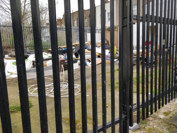 Dumped rubbish in the back garden of Glory Dale Inn at 135 Leytonstone Road E15-4 Henniker Road, London, E15 1JZ