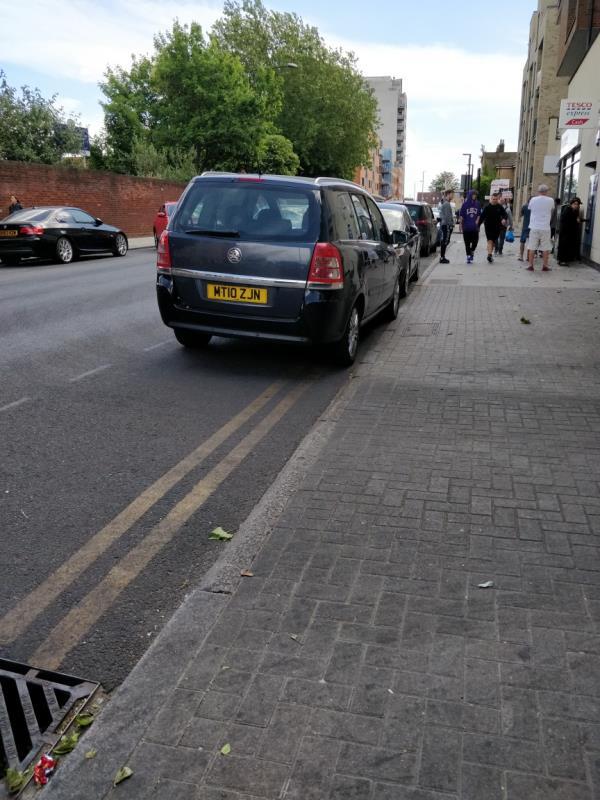 car parked on double yellow lines beside 113 Leytonstone Road E15-113 Leytonstone Rd, London E15 1HD, UK