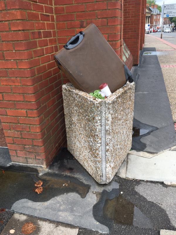 Suitcase dumped on top of bin-45 Castle Street, Reading, RG1 7TH