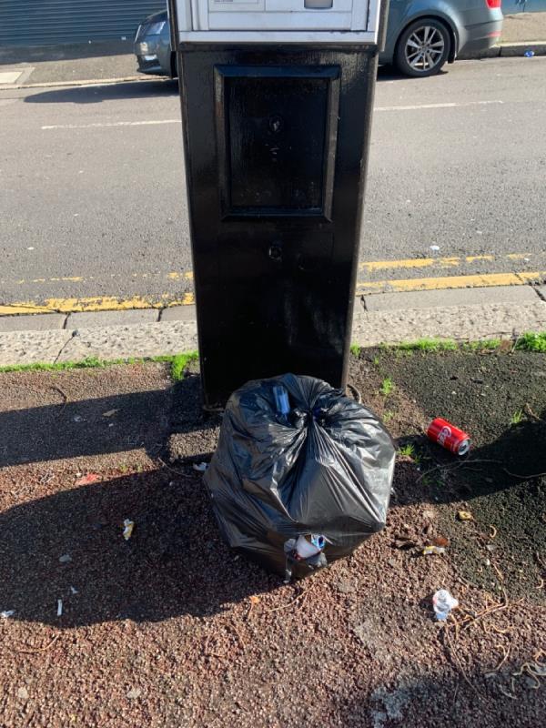 Bin bag. Parking meter-1 Carlton Road, London, E12 5AD
