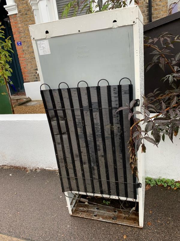 Fridge dumped outside 17 Macdonald Road, blocking the pavement for wheelchairs/buggies.-15 MacDonald Rd, London E7 0HE, UK