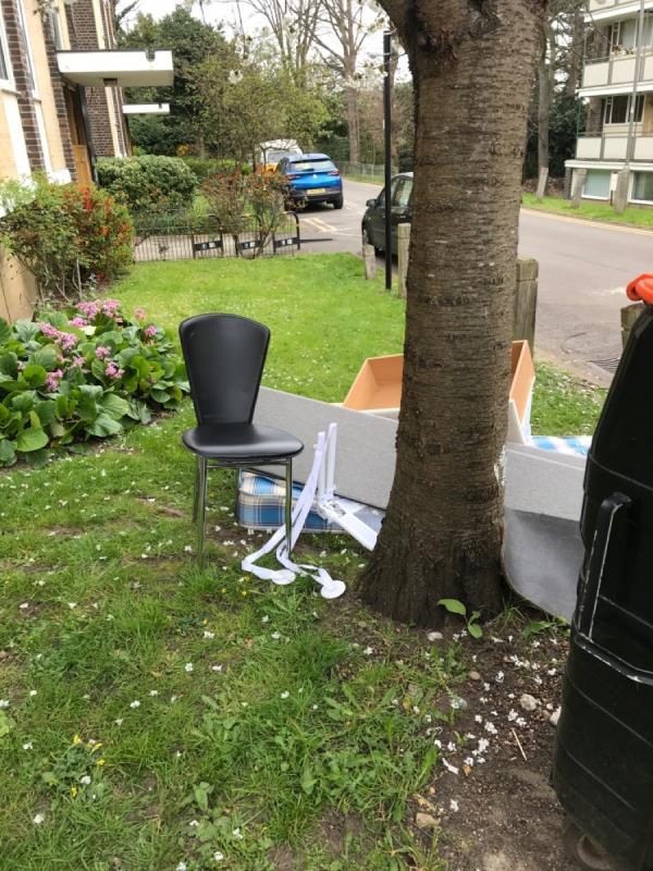 Furniture left outside green area-26 Winterfold Close, Wimbledon, SW19 6LE