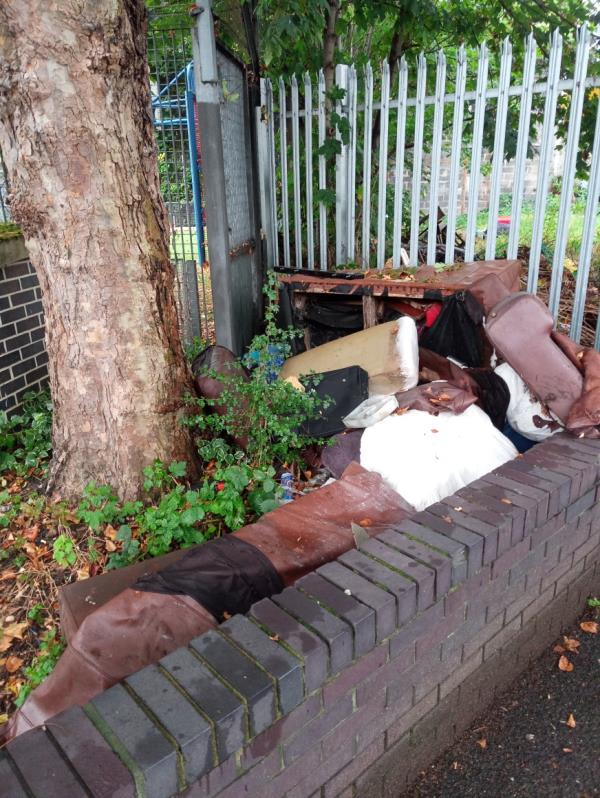 A dumped wet and damaged brown sofa has been dumped at the back of Forest Gate Youth Zone at the start of Clinton Road, E7-19 Dames Rd, London E7 0DS, UK