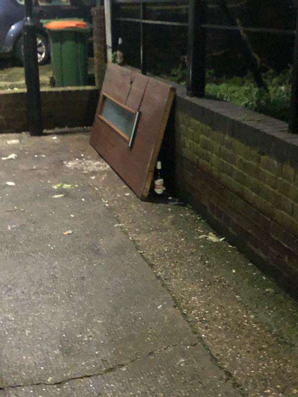 Dumped items - door and bottles -5 Augurs Lane, Plaistow, E13 9JX
