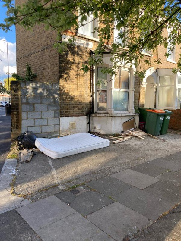 Mattress, black bin bags, discarded wood planks -172a Kingsland Road, Plaistow, E13 9NU