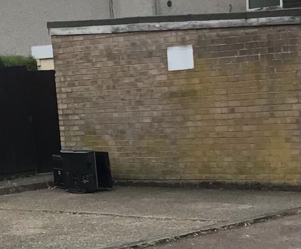 Dumped televisions rear of 61 rowanberry Avenue on car park.-29 Rowanberry Avenue, Leicester, LE3 6PN