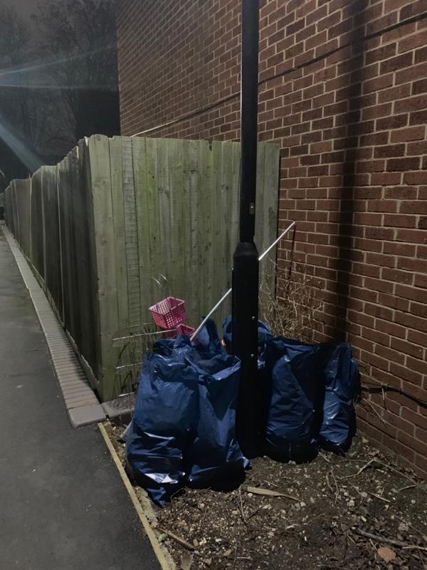Mavis Walk next to street light 8. Bags of broken tiles and household waste-10 Denny Close, London, E6 5