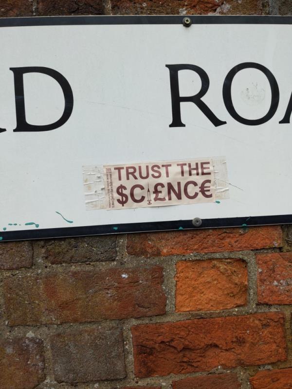 Anti-vaccination sticker on Peppard Road street sign-65 Prospect Street, Reading, RG4 8HJ