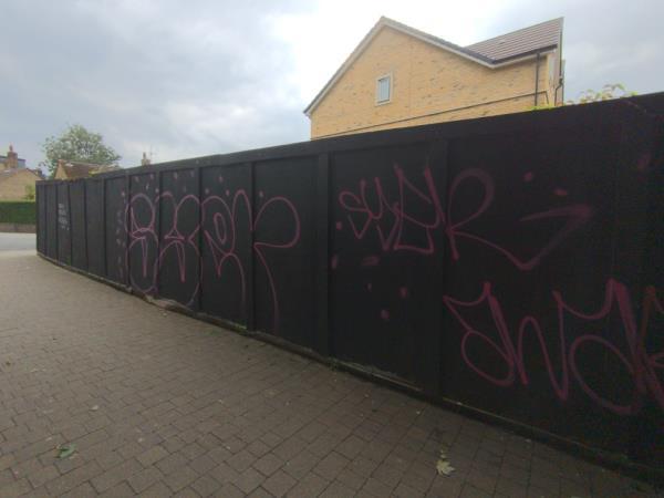 Graffiti along hoardings-Zoom Day Nursery Maythorne Cottages, London, SE13 6HE