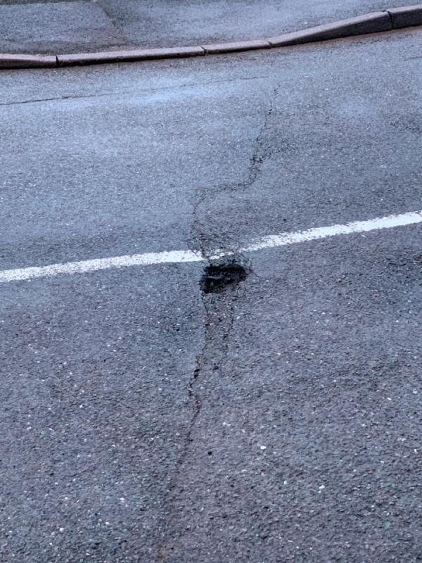 Pot hole in road-66 Wells Road, Wolverhampton, WV4 4BH
