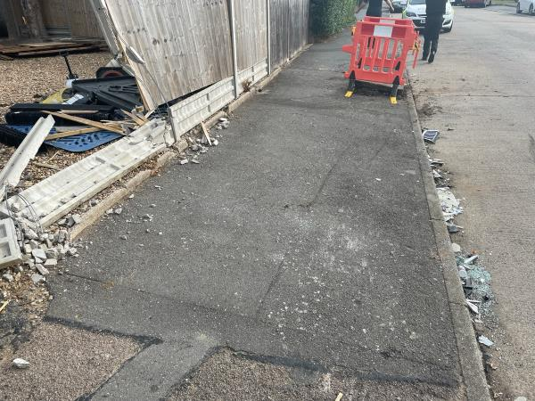Rubble and other mess left on pavement at location. image 2-18 Monmouth Drive, Leicester, LE2 9RJ