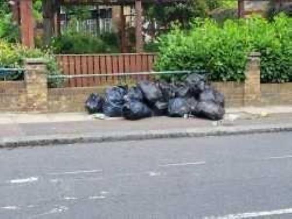 Junction of Marsala Road. Please clear flytip of black bags-209a Algernon Road, Lewisham, SE13 7AG