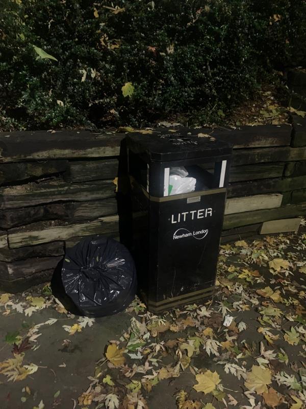 Fly tipped bag of rubbish next to bin on Mavis Walk / Mitchell Walk intersection. Becoming a regular occurrence. Bin is also full-12 Mavis Walk, London, E6 5SG