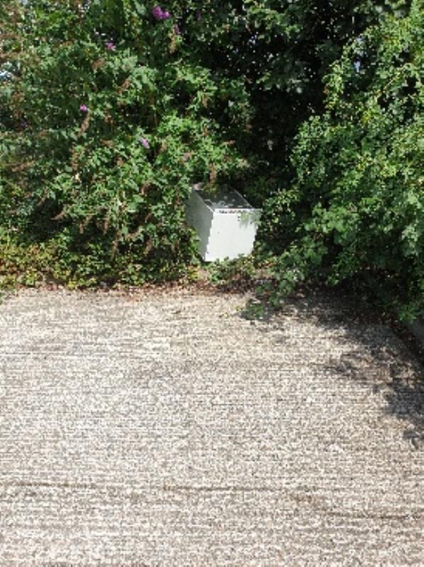 fly tipping in bushes South of 20 Houseman-21 Houseman Road, Farnborough, GU14 8QF
