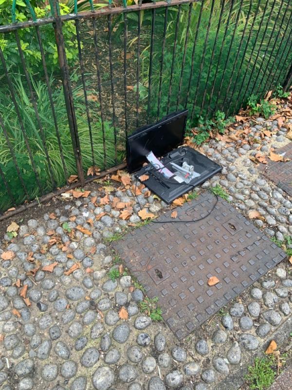Two televisions dumped in front garden of 1-7 Henniker Road-6 Henniker Rd, London E15 1LQ, UK