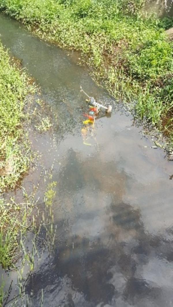 child tricycle dumped in brook between kingsley and manor jr school -19 Kingsley Road, Farnborough, GU14 8SU