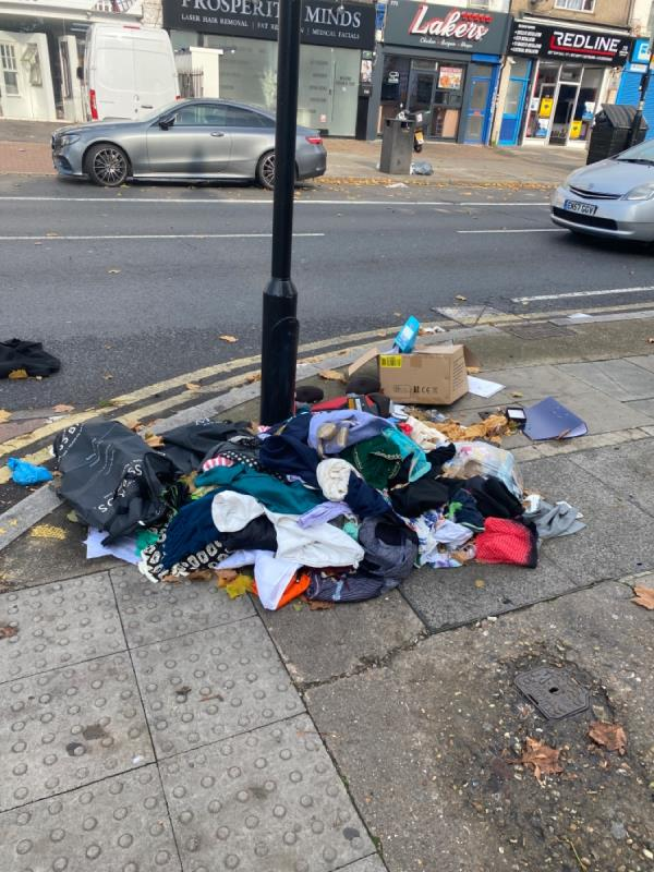 Clothes been dumped by residents without any council own bins -3a Meanley Rd, Aldersbrook, London E12 6AR, UK