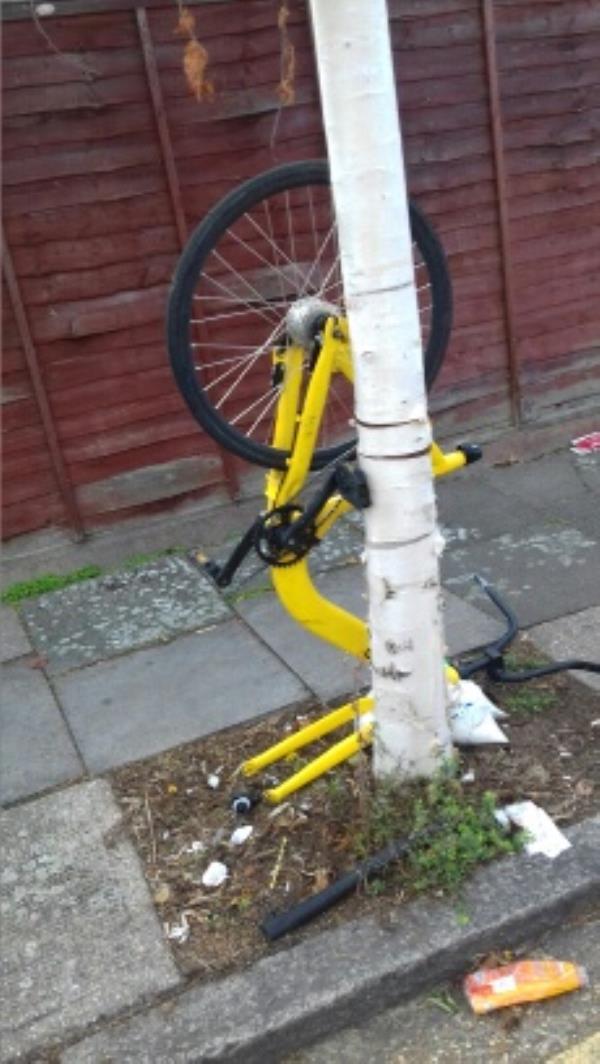 A broken bike dumped opposite 27 St Clair Road -12 St Clair Road, London, E13 9DU