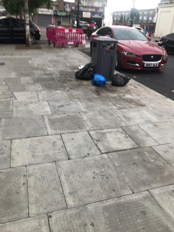 Rubbish next to bin-12 Sebert Road, London, E7 0NQ