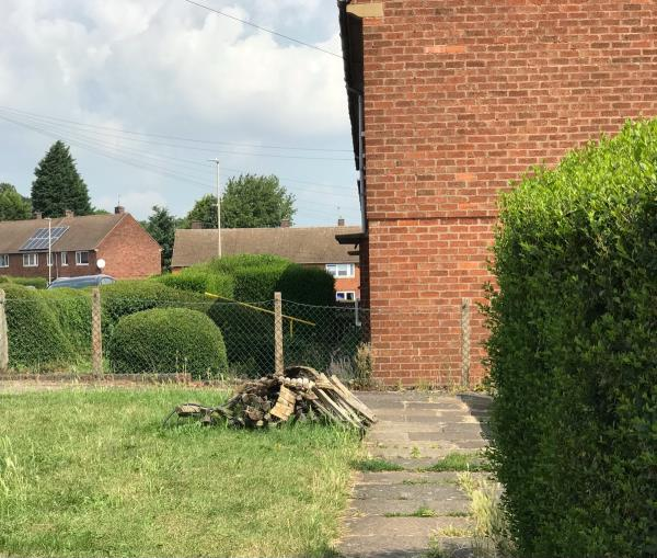 Broken fences dumped on the green area-25 Biddle Road, Leicester, LE3 9HJ