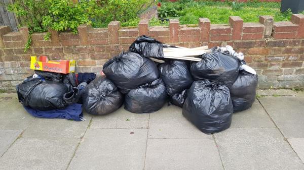 Bags of rubbish bottom Fordel Road junction St Fillans -27 Saint Fillans Road, London, SE6 1DQ