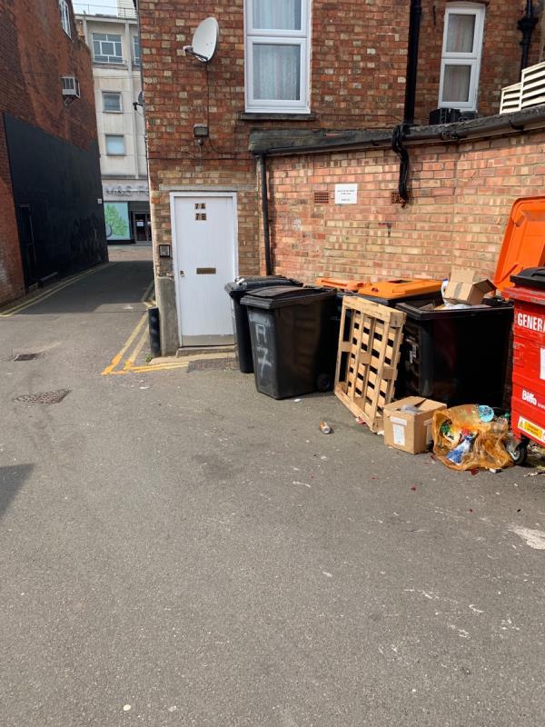 Loose pallets and waste dumped along the highway in Hawes Court.  image 1-7 Harpur St, Bedford MK40 1LA, UK