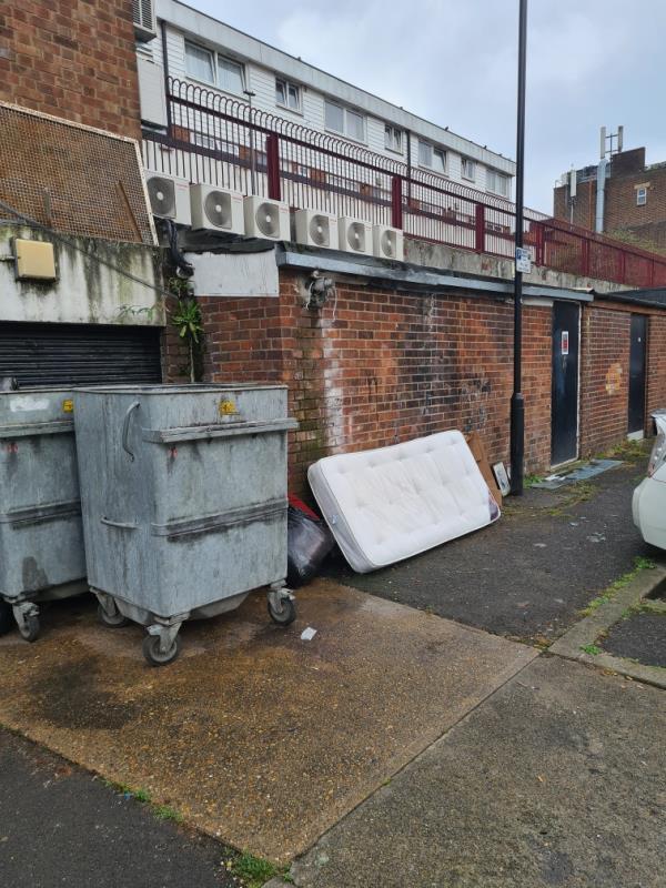 Mattress dumped near bins in service road behind Barking Rd-40 Castle St, London E6 1PW, UK