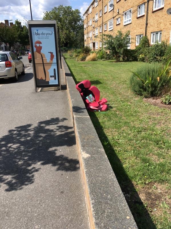 Baby car seat abandoned in Council garden .  -145 Lonsdale Avenue, London, E6 3PR