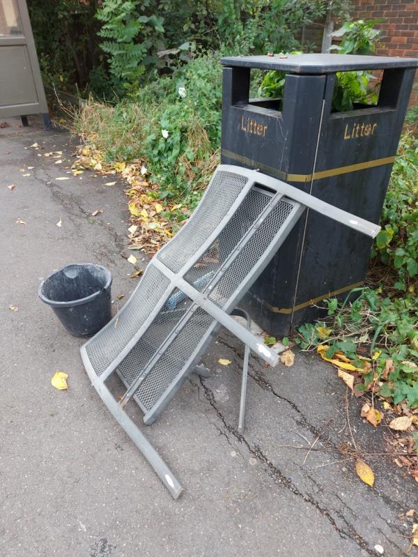 Fulmer Road Bus Stop. Metal garden bench and URGENT dead pet Ferret in bucket attracting vermin and flies .-Fulmer Road, London E16 3TW, UK