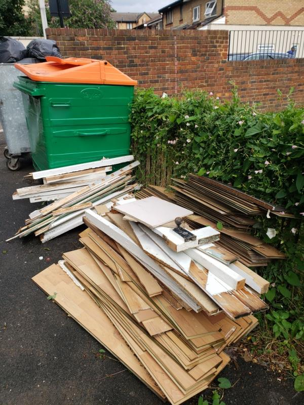 Large amount of boards that have been flytipped by the bins at the end of Francis street. -33 Maryland Street, London, E15 1JD