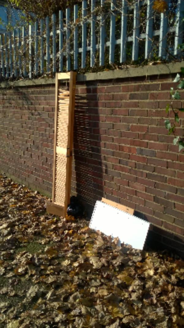 nr 2 Valetta Grove E13: Door shutter, wood panels-2 Valetta Grove, London, E13 0JR