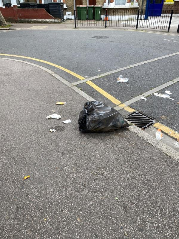 Black bag with food waste -7b, 100 Rosebery Ave, London E12 6PS, UK