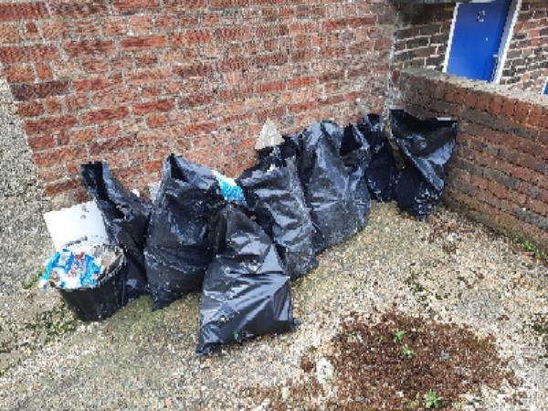 homes first - bags of builder rubble in rear car park of Dorset Court-Dorset Court Langney Road, Eastbourne, BN21 3QG