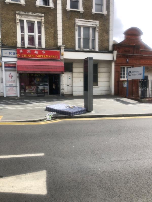 Old mattress on the pavement.-198b The Grove, London, E15 1EN