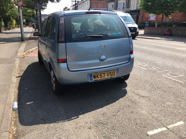 Hi this has been parked in front of Oxford road primary school for over 6 weeks. It hasn't moved and has numerous tickets. -211-221 Oxford Road, Reading, RG1 7PJ