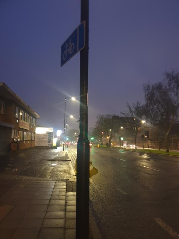cycle sign on lamp column dislodged-24 Haliday Square, Southall UB2 4UG, UK