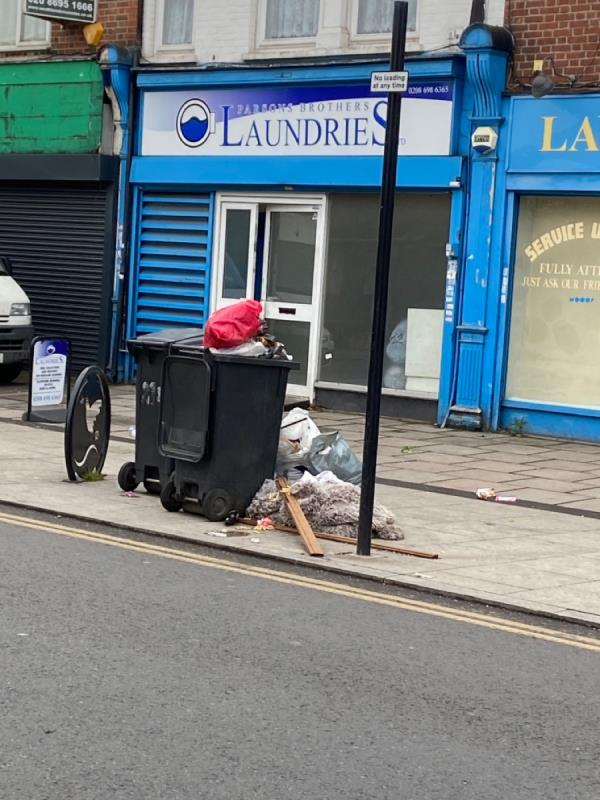 Overflowing bins and household junk-211 Sangley Road, London, SE6 2DY
