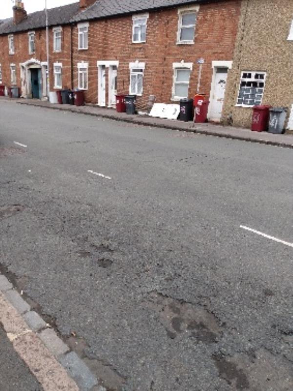 dumped door and broken window outside on public path-58 George Street, Reading, RG1 7NT