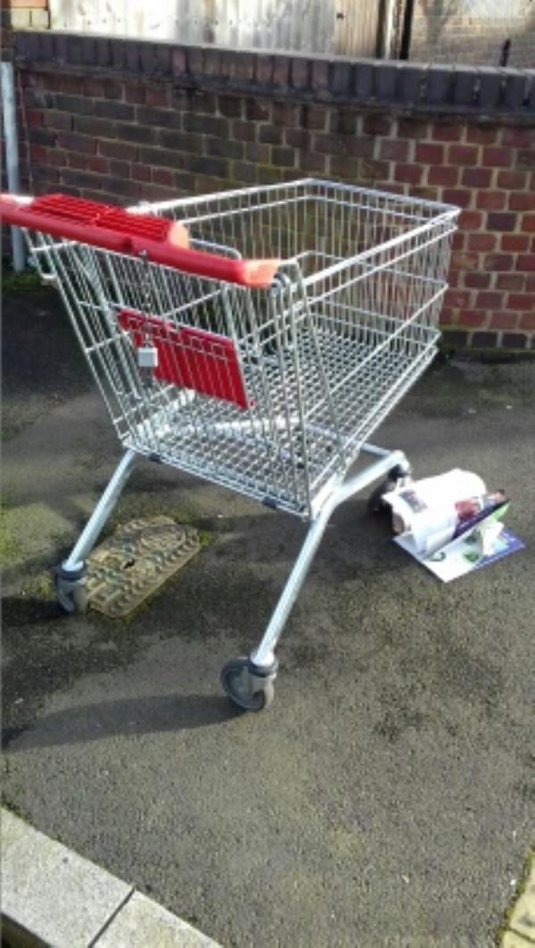 A shopping trolley dumped at Wigston Road junction near 16 Crofton Road -18 Crofton Road, London, E13 8QS