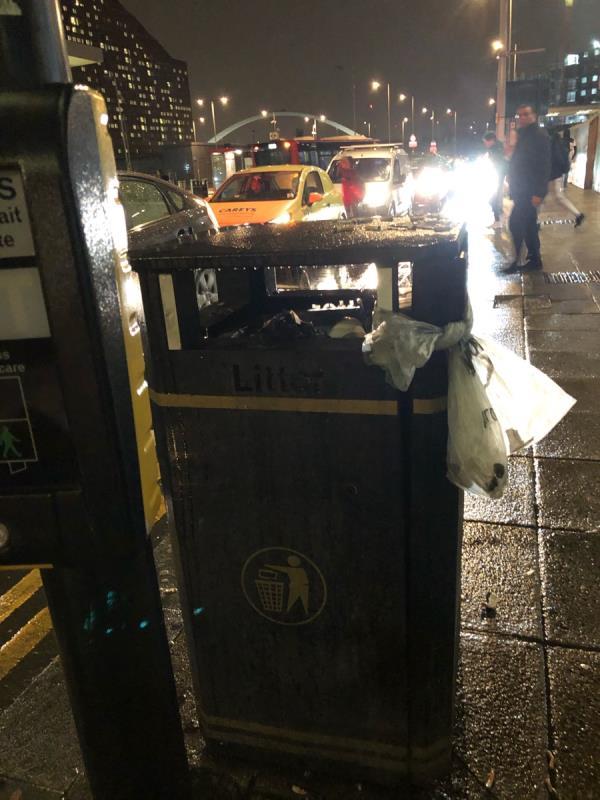 Bin overflowing again outside Stratford international DLR station -5 Celebration Avenue, London, E20 1DB