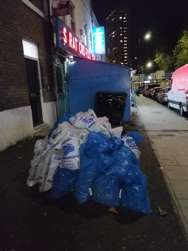 Construction waste materials on the pavement beside 103 Leytonstone Road E15-104b Leytonstone Road, London, E15 1TQ