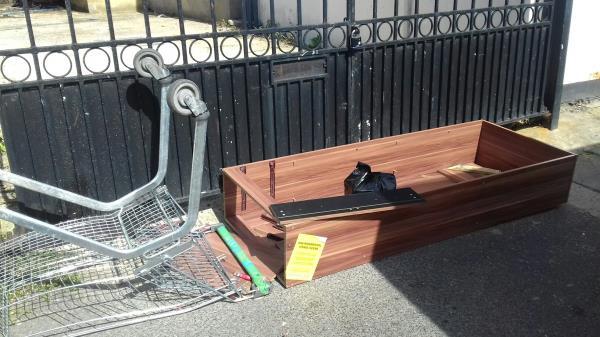 A broken cupboard and a shopping trolley dumped near 137 Grosvenor Road E7 -135 Grosvenor Road, Green Street East, E7 8JB