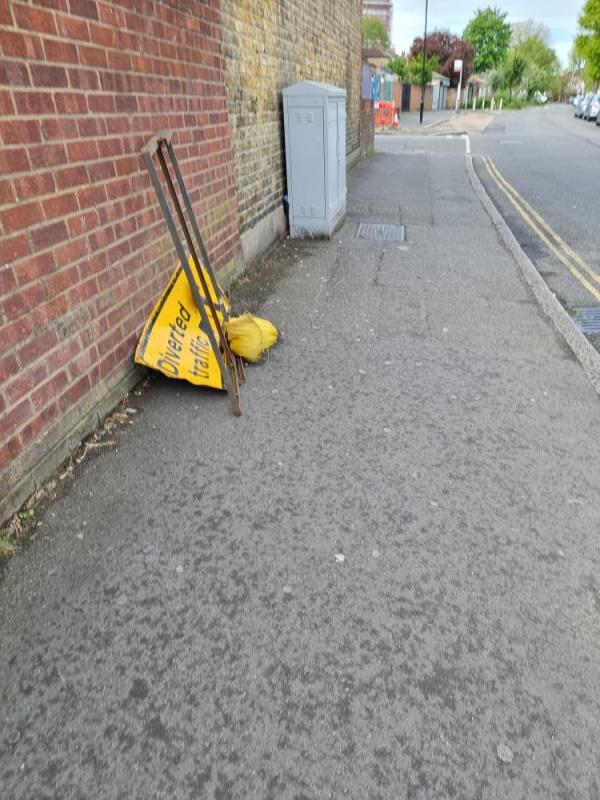 Divert traffic sign on pavement-30 Hamilton Road, London, UB1 3BT