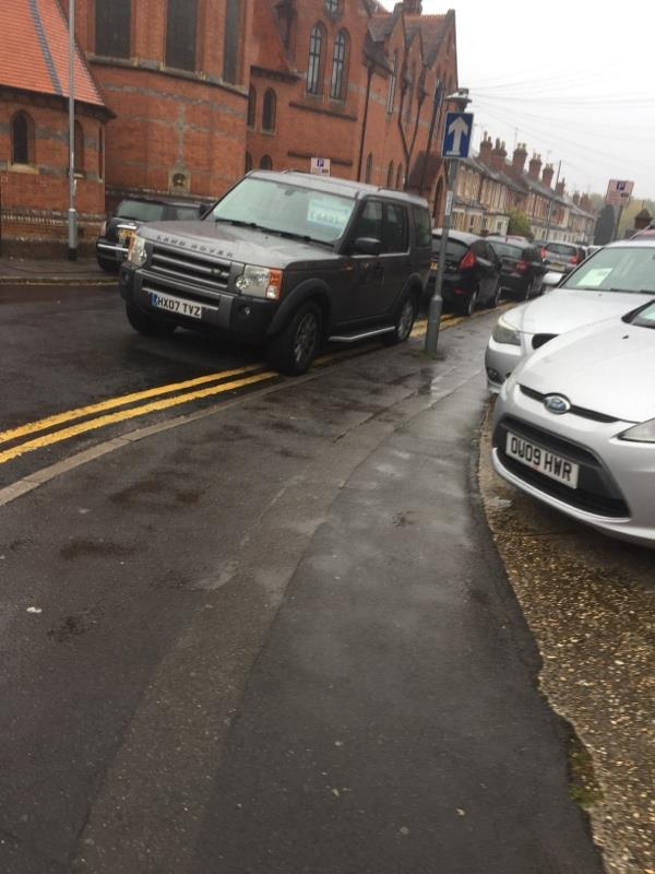 Illegal parking, I will keep reporting this this until you do something about it. Just issuing warnings to the owners is clearly not working, they are flouting the no parking here, and taking the mickey of pedestrians -37 Erleigh Road, Reading, RG1 5NB