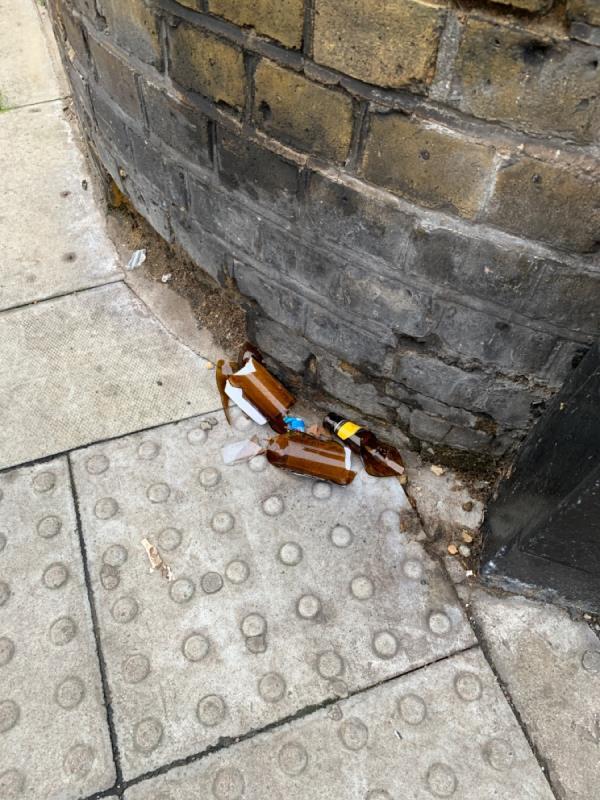 Broken bottle outside school-17 Sheep Lane, London, E8 3FP