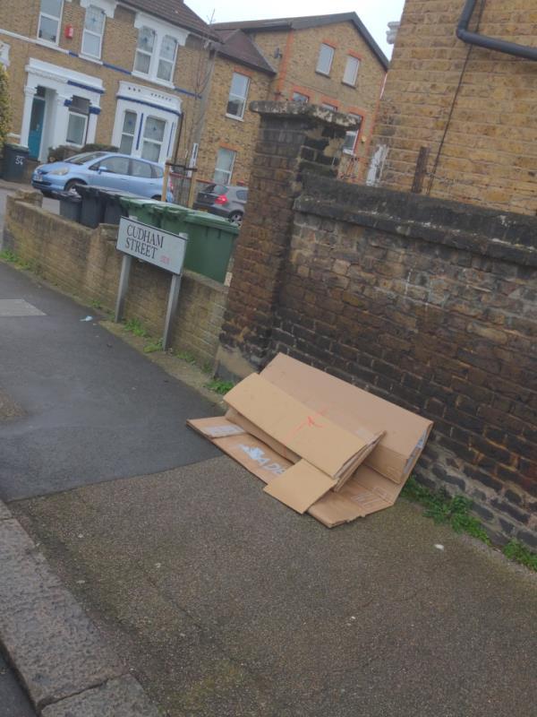 Fly-tipped cardboard at corner of cudham Street and ringstead Road.-2 Cudham Street, London, SE6 2JA
