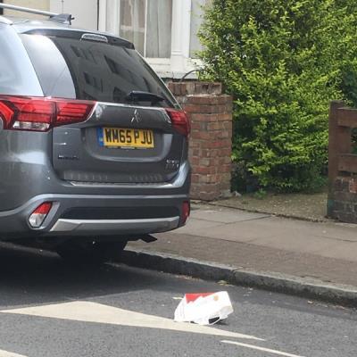 Food waste and packaging left at kerbside. -22 Walford Rd, Stoke Newington, London N16 8ED, UK